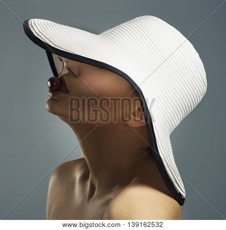 Beauty Woman Face Portrait In A White Hat. Beautiful Model Girl With Perfect Clean Skin. Female Look