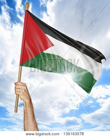 Person's hand holding the Palestinian national flag and waving it in the sky, 3D rendering