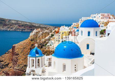 Church With Blue Domes On Santorini Island, Greece.