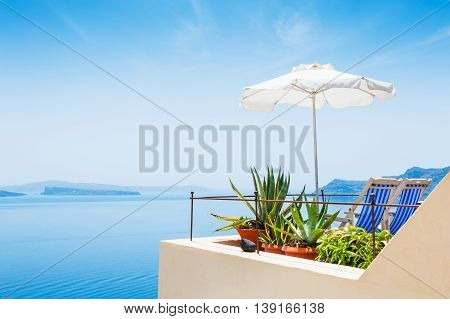 Two Deck Chairs And Beach Umbrella