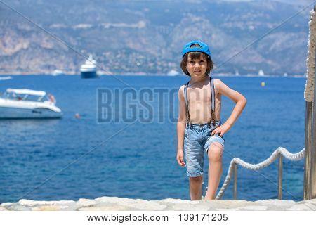 Cute Child, Standing On A Path Around Mediterranean Sea On French Riviera