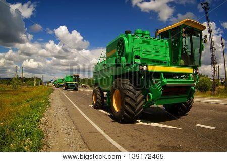 Harvester Driving On Asphalt Road