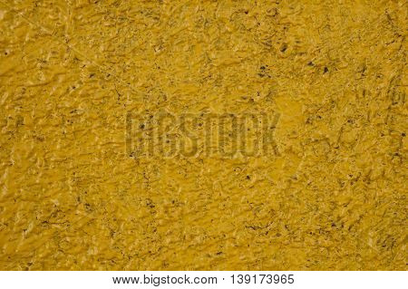 abstract background - embossed dark yellow painted wall