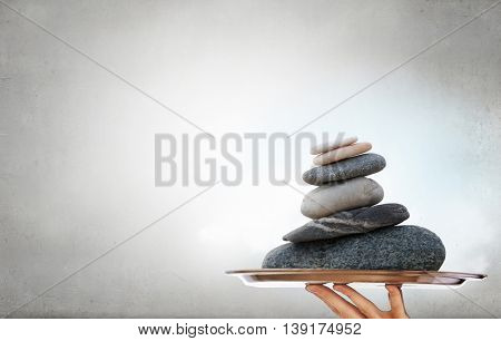 Stones massage procedure . Mixed media