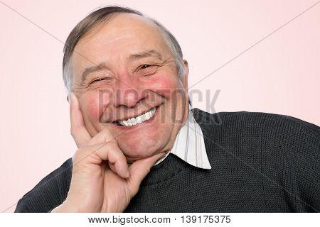 Portrait of an elegant senior man isolated on white background