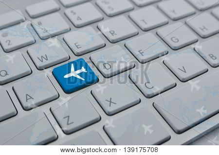 Airplane icon on modern computer keyboard button with world map and flight routes Transportation concept Elements of this image furnished by NASA