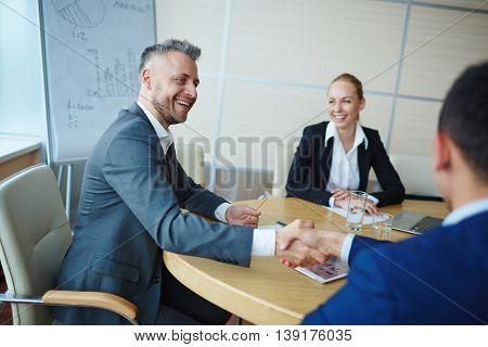 Congratulating colleague