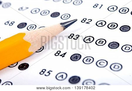 Test answer sheet with pencil. Examination test. Education concept
