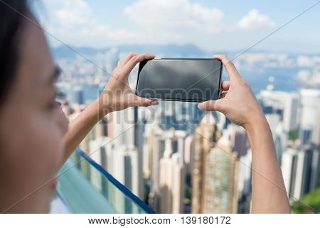 Woman taking photo of Hong Kong city