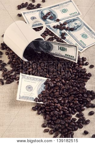 Cup Coffee Beans Scattered On Dollar Photo