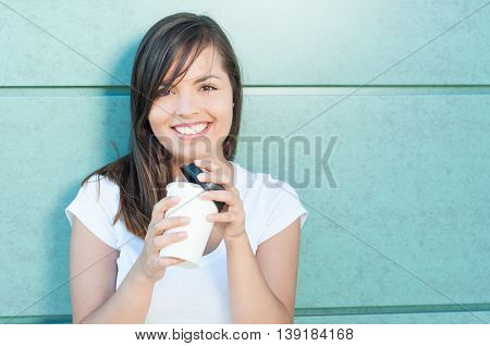 Happy Pretty Girl Holding Cup Of Takeaway Coffee