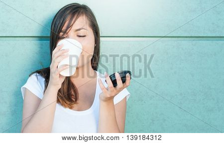Beautiful Young Lady Holding Coffee Mug And Drinking