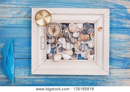 Frame With Compass And Blue Paper Boat