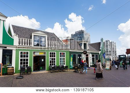 Zaandam Netherlands - July 02 2016: Some people at the Zaandam Central Railroad Station famous building of traditional architecture in Dutch region