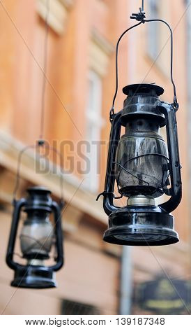 Kerosene Lamp On The Background Of The Old House, The Old Streets.
