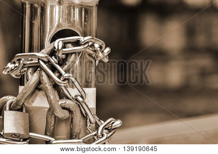 Two padlock with chains in sepiea light