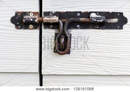 latch door on wooden siding fiber cement board