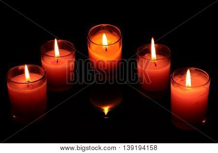 Light a candle in the dark red and pink faith to relax and celebrate.