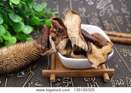 Chinese herbal drugs and dried tree on white bowl