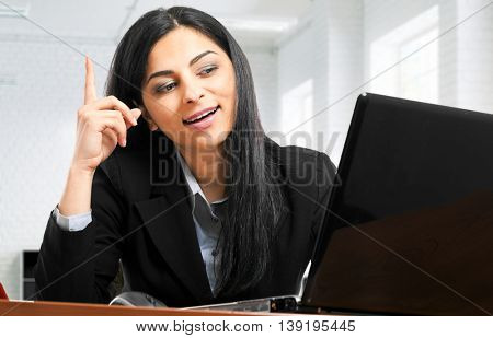 Pensive businesswoman at her desk