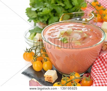 Soup gazpacho with yellow tomatoes on a white background