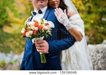 Wedding Couple Background Stones And Lake At Autumn