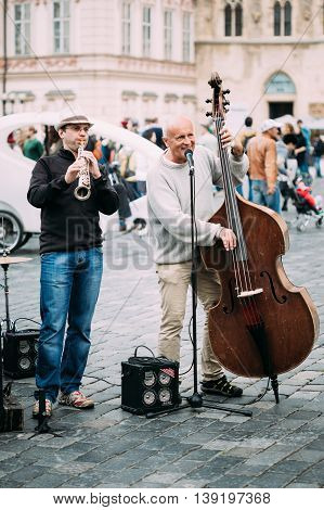 PRAGUE, CZECH REPUBLIC - OCTOBER 10, 2014: Street Busker performing jazz songs at the Old Town Square in Prague. Busking is legal form of earning money on Prague Streets.