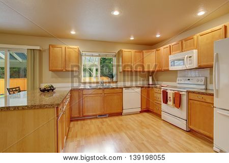 New Classic Wood Large Kitchen With Grey Counter Top.