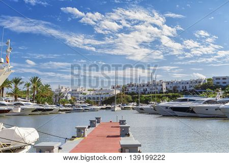 view of the Cala D'Or yacht marina harbor with recreational boats. Mallorca, Spain