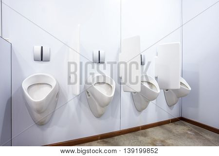 urinals in an old building for men only