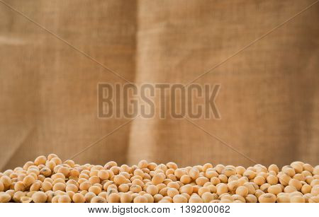 Soybeans with sackclote background.Selective focus on front soybeans.