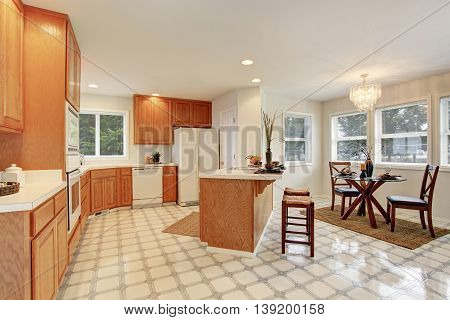 Kitchen Room Interior With Brown Cabinets And Dining Area