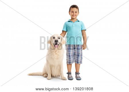 Cute little boy posing together with a young Labrador retriever dog isolated on a white background