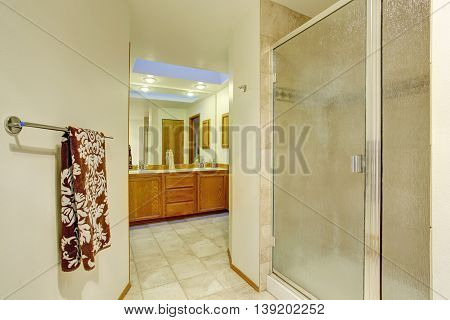 Nice Master Bathroom With Brown Cabinets