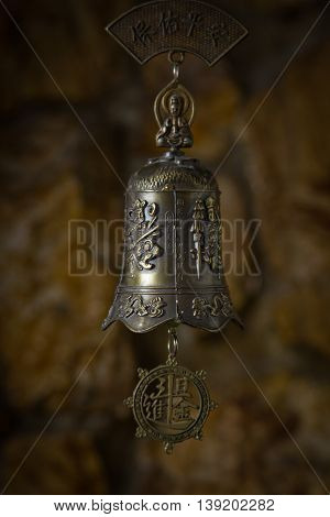 a beautiful bronze bell in the background