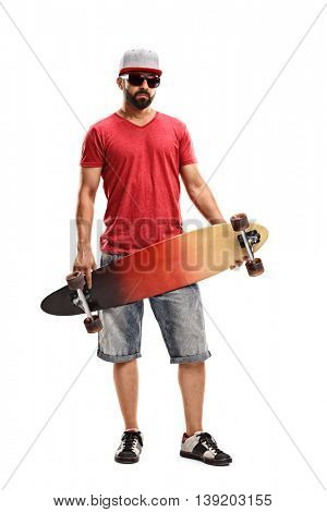 Full length portrait of a man holding a longboard and looking at the camera isolated on white background