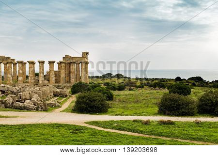 Antic ruins from early human societies. Mediterranean landscape with sea and sky in the background.