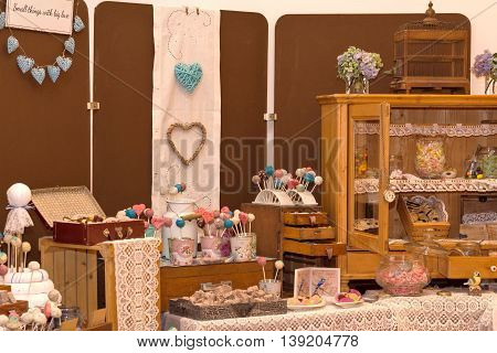 caused abundance of Cake-pops and other dessert on old wood furniture