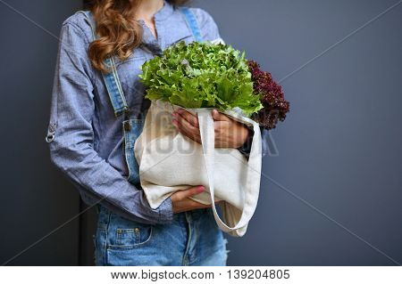 Linen Bag With Lettuce Salad In Woman Hands