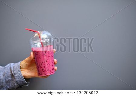 Disposable Cup With A Smoothies In Woman Hand
