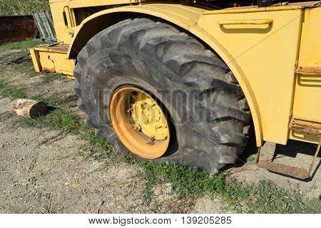 Broken Flat Tire On A Large Tractor