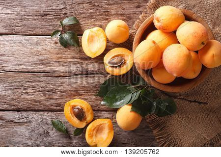 Ripe Apricots In A Wooden Bowl On The Table Closeup. Horizontal Top View
