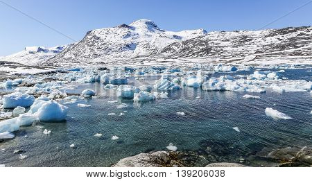 Iceberg lagoon nearby Qoornoq former fishermen village Greenland