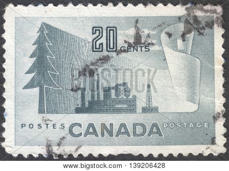 MOSCOW RUSSIA - CIRCA JANUARY 2016: a post stamp printed in CANADA shows image of a tree and an industrial plant the series