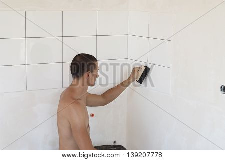 Laying Ceramic Tiles On A Wall