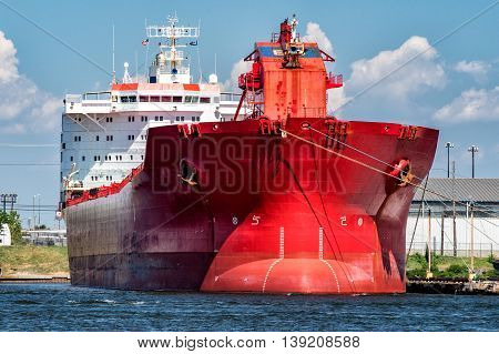 Red Oil Tanker Ship Prow View On Sunny Day