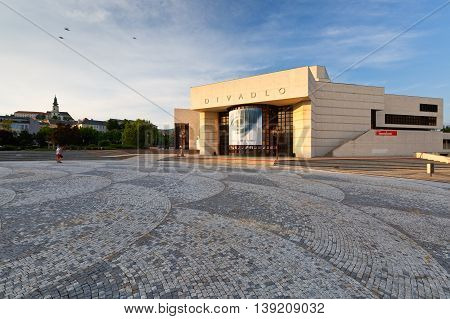 NITRA, SLOVAKIA - JULY 02, 2016: Building of the theatre of Andrej Bagar in Nitra and Nitra castle on July 02, 2016.