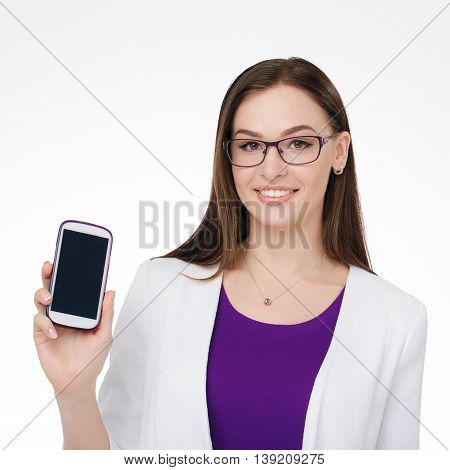 young businesswoman smiling with cell phone in the hand