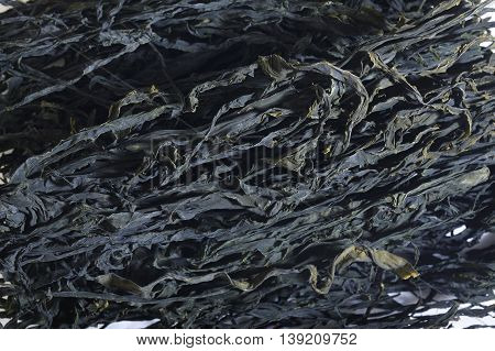 dried wakame seaweed food at on background