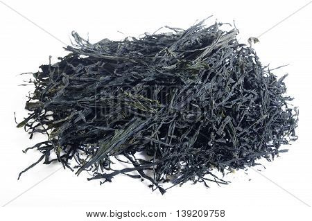 dried green seaweed on a white background